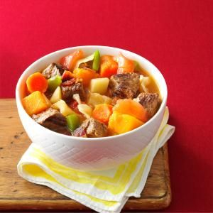 "Loaded Vegetable Beef Stew Recipe -I first had this dish during a trip to Argentina a few years ago. It inspired me to recreate it at home. It turned out so well, I wrote ""Yum!"" on the recipe card! —Kari Caven, Post Falls, Idaho"