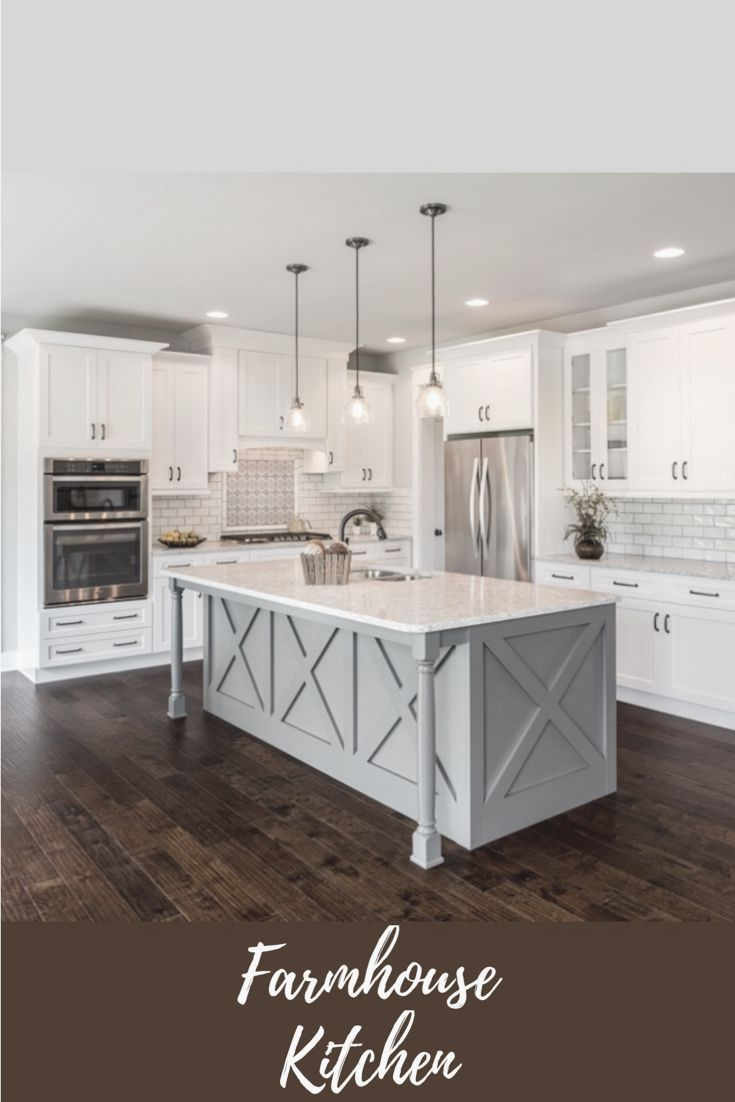 I love the island bar in this farmhouse kitchen with the glass pendant lights hanging above. The subway tile adds a nice modern twist. #ad