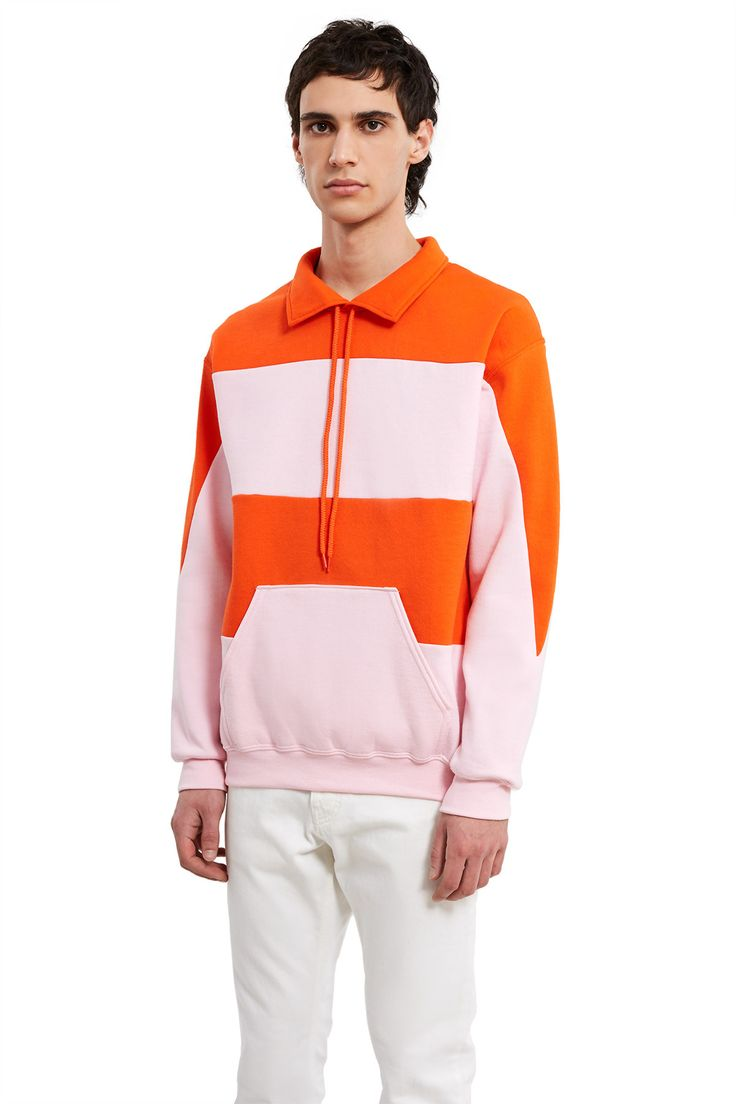 Opening Ceremony Re-Editions, Striped Rugby In 2005, Carol and Humberto combined a hoodie with a polo creating the Rugby-inspired top that featured two-tone striped panels and a drawstring golf collar. For the Opening Ceremony Re-Editions series, we bring back the Striped Rugby in the original orange and pink colorway., OC EXCLUSIVE, Unisex, Drawstring spread collar, Kangaroo pocket, Ribbed cuffs and hem, Dropped shoulders, Oversized fit, 50% cotton, 50% polyester, Made in USA