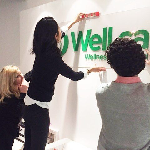Hanging up our new #welldotca sign in the #Toronto office!