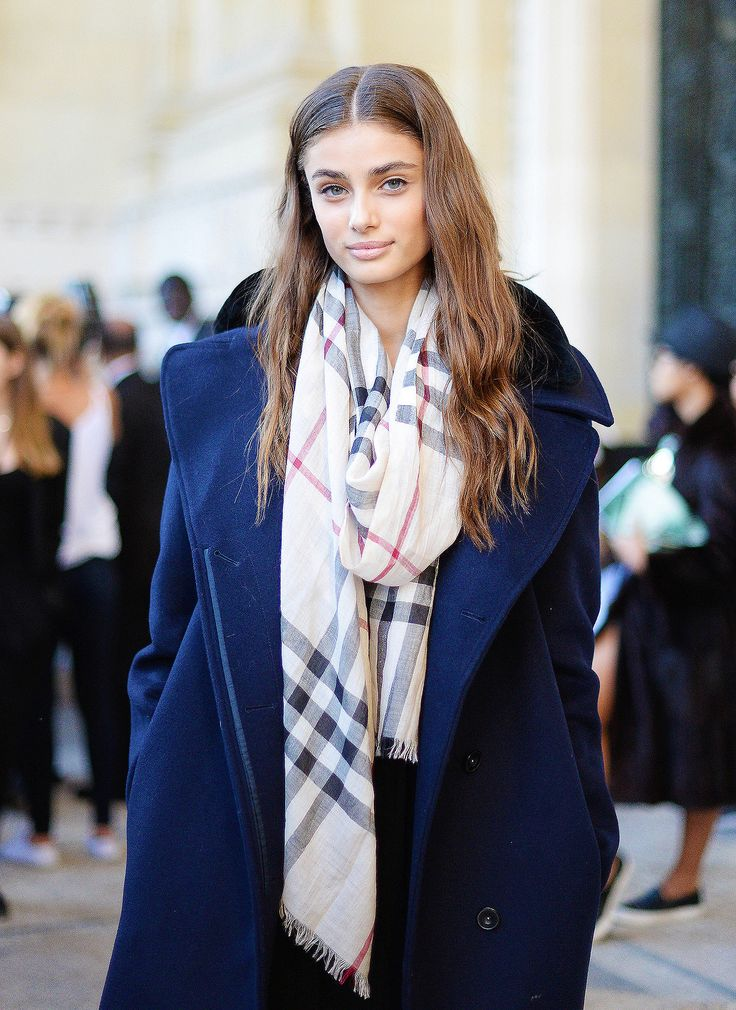 Model Taylor Hill executes off-duty ease in a beautiful blue coat and Burberry scarf.