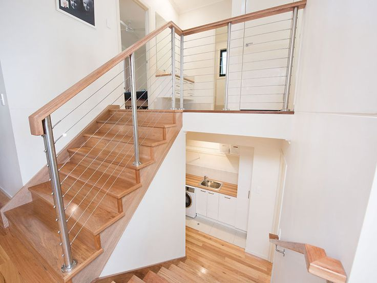 Beautiful and modern all timber staircase with stainless steel balusters | Tru-Built Builders Queensland