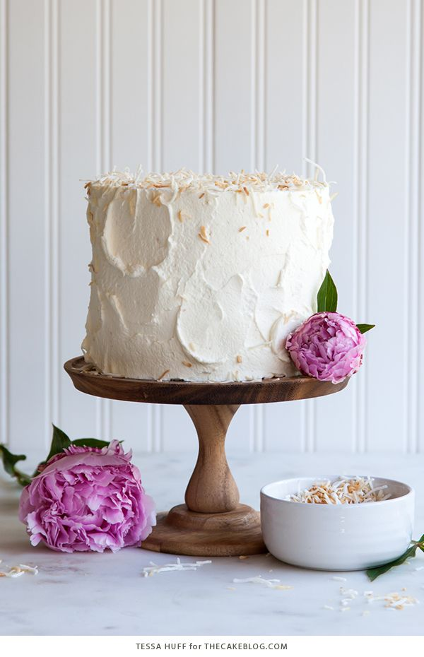 A coconut tres leches layer cake soaked with coconut milk, frosted with stabilized whipped cream and toasted coconut flakes.