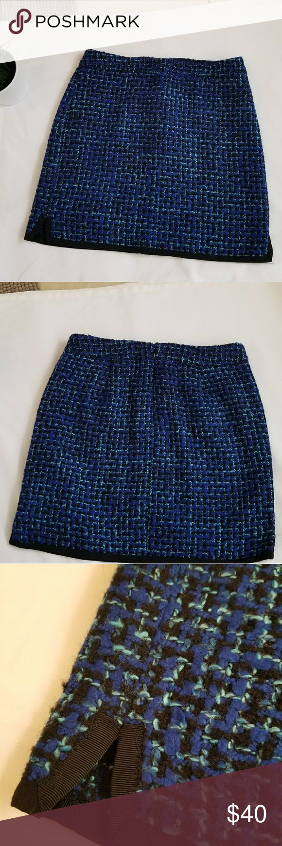 J. CREW Postage Stamp Mini Tweed Skirt Beautiful mini tweed skirt in Indigo. Has a beautiful black trim around bottom which pops. Small zipper in back. Skirt is lined with 100% polyester. Outer material is 61% acrylic, 19%polyester, 10%wool, 9% cotton, 1%nylon. Some piling/fraying, but typical of this material. Otherwise in great condition. Waist measures at about 16 in. From waist to bottom is about 17 in. J. Crew Skirts Mini