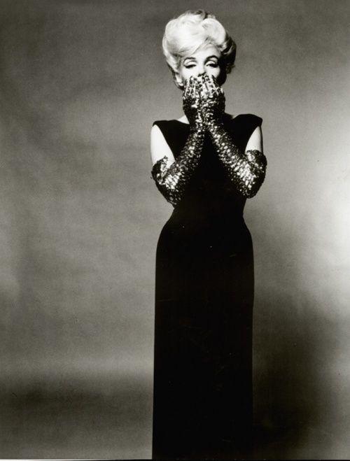 black gown, embellished gloves, big hair.
