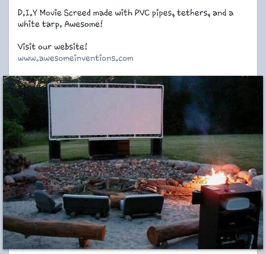 DIY outside movie theater screen - PVC frame, white tarp screen and tethers to hold it all together.