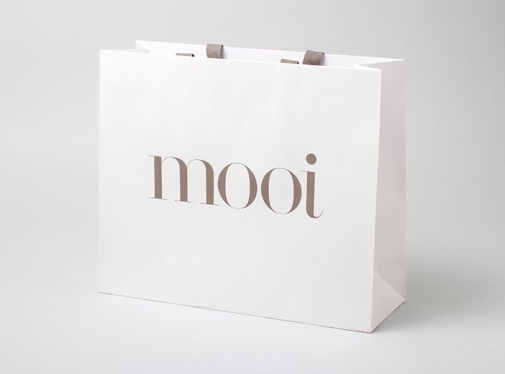 Logo and paper shopping bag designed by Morse Studio for fashion boutique Mooi. #Branding #Design