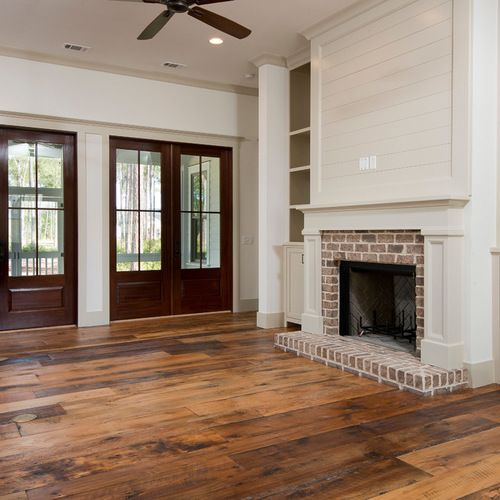 Living Room With Fireplace And Sliding Doors: Low Country House With Classic Lines. Painted Shutters