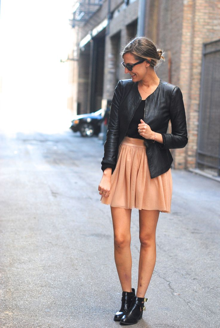 LOVE this outfit- contrast feminine skirt with edgy jacket and boots