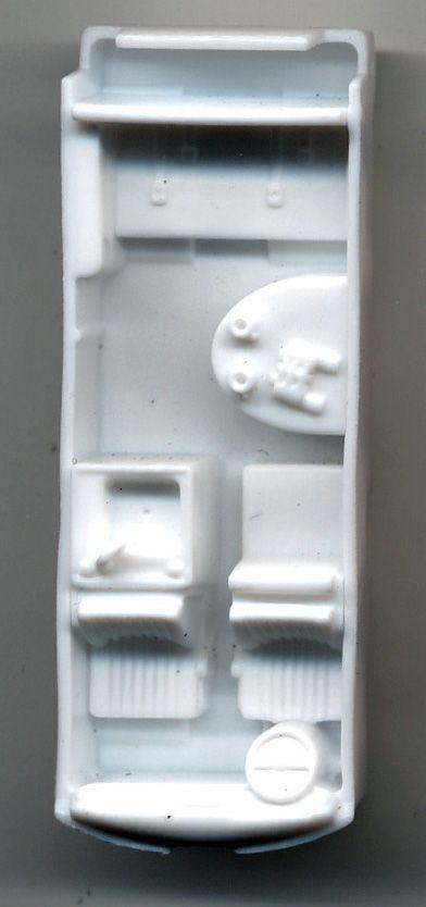 Inside Matchbox 1970 Volkswagen Kombi. Sink, table, cups, binoculars.