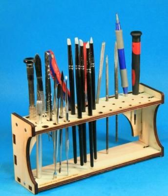 """FFR-T-WH001 Universal Tool Holder Imported from Germany. Laser cut wood Tool Holder.  8l"""" x 2""""d x 4""""h. Minor assembly required. The universal tool holder has space for 29 tool"""