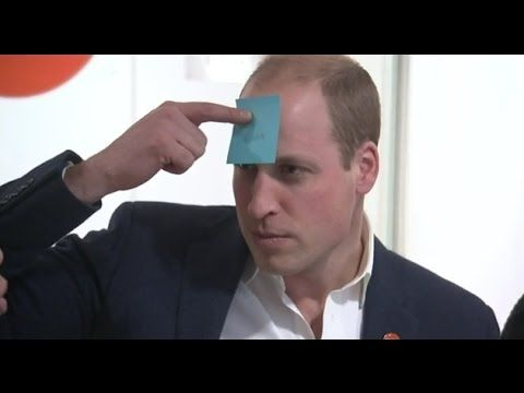 Prince William plays post-it note game on visit to homless hostel (Janua...