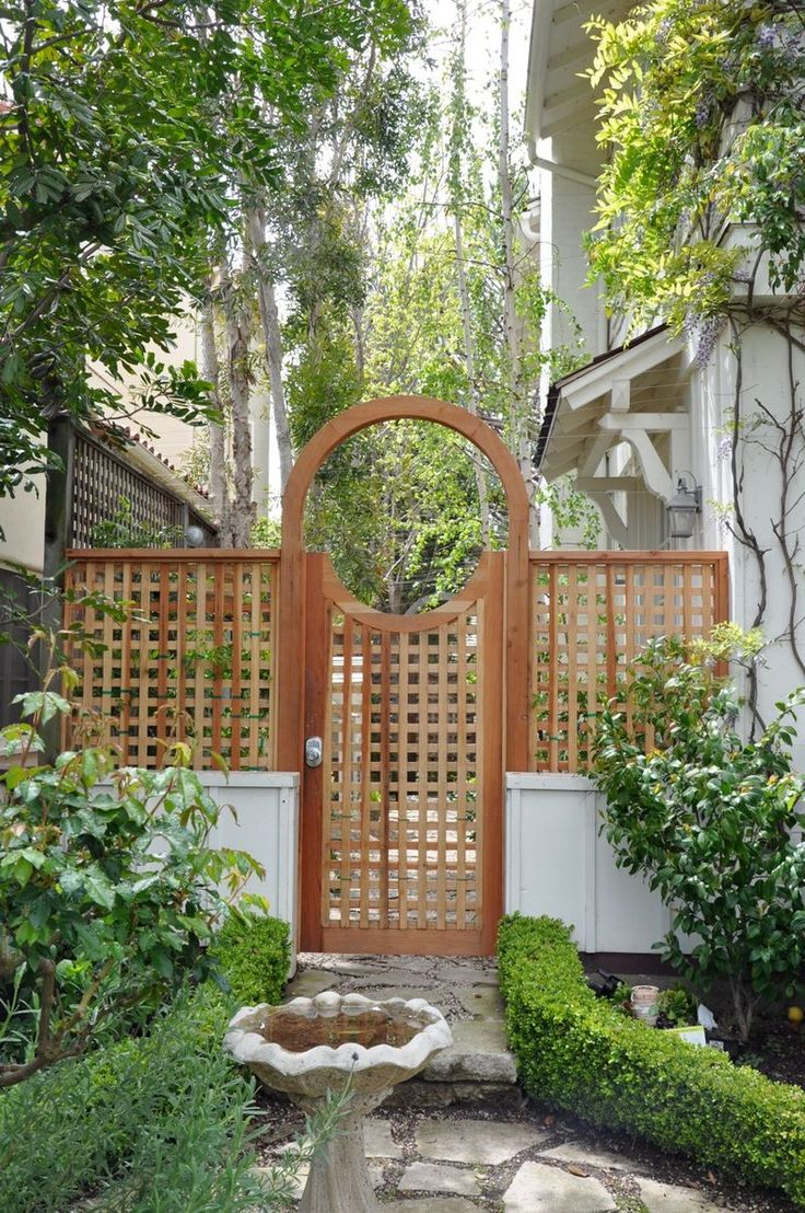 50 best trellis images on pinterest creepers garden for Fence with arbor