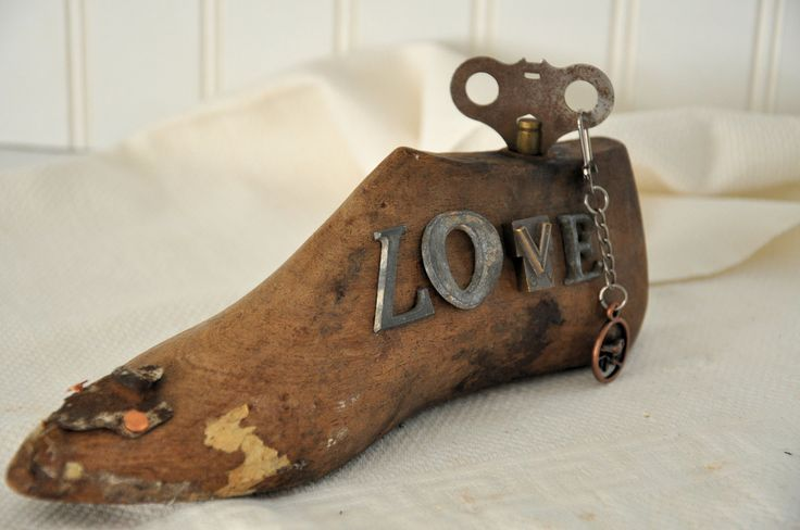 Wood shoe form assemblage with love spelled out using vintage metal letters. $35.00, via Etsy.