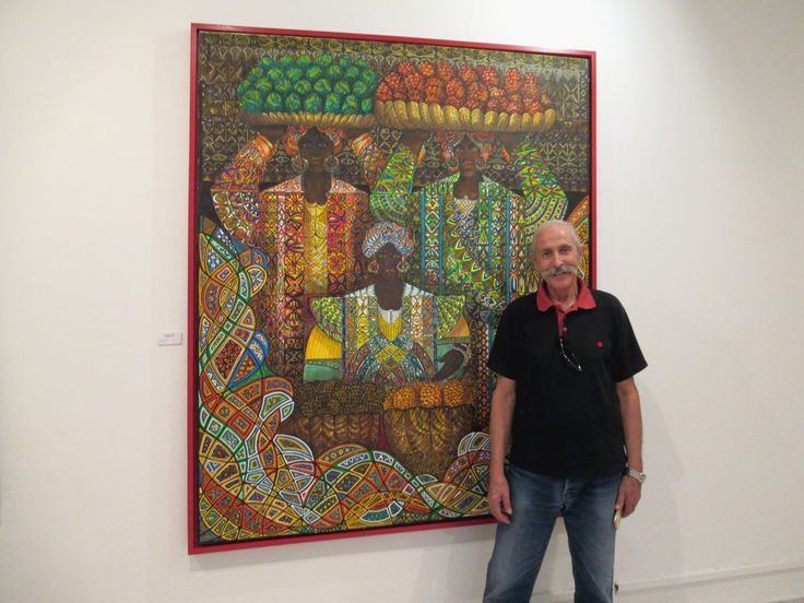 Tunisian artist Ismail Ben Fredj poses before one of his works at La Maison des Arts in Parc du Belvédère, Tunis.
