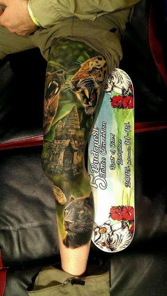 Realistic jungle theme tattoo.  Panther tigers