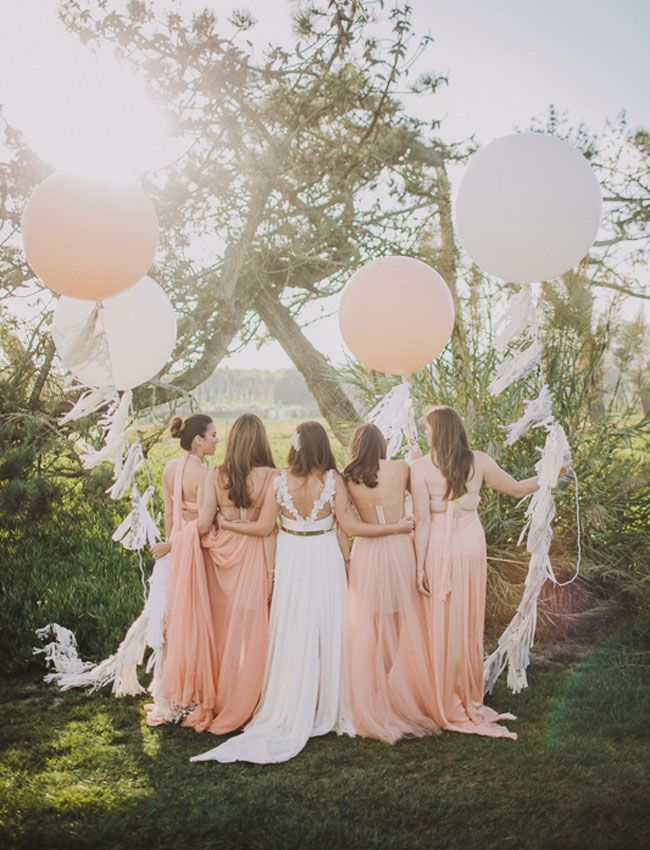 pink maids with balloons make us swoon