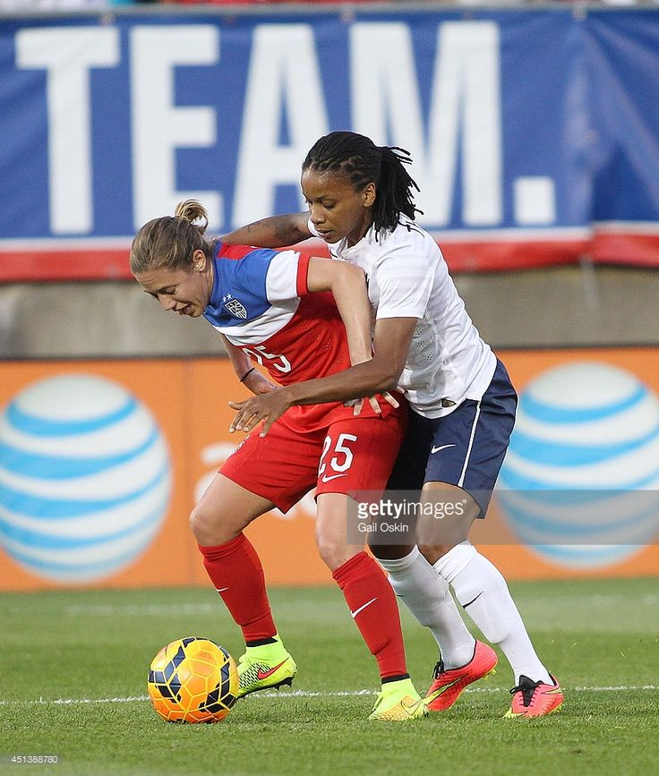 Meghan Klingenberg #25 of the United States fights for the ball with Elodie Thomis #12 of France during a women's international friendly match between France and the United States June 19, 2014 at Rentschler Field in East Hartford, Connecticut.