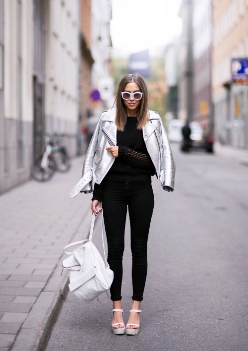 Shop this look on Lookastic:  http://lookastic.com/women/looks/sunglasses-jacket-crew-neck-sweater-skinny-jeans-heeled-sandals-backpack/8245  — White Sunglasses  — Silver Leather Jacket  — Black Crew-neck Sweater  — Black Skinny Jeans  — White Leather Heeled Sandals  — White Leather Backpack