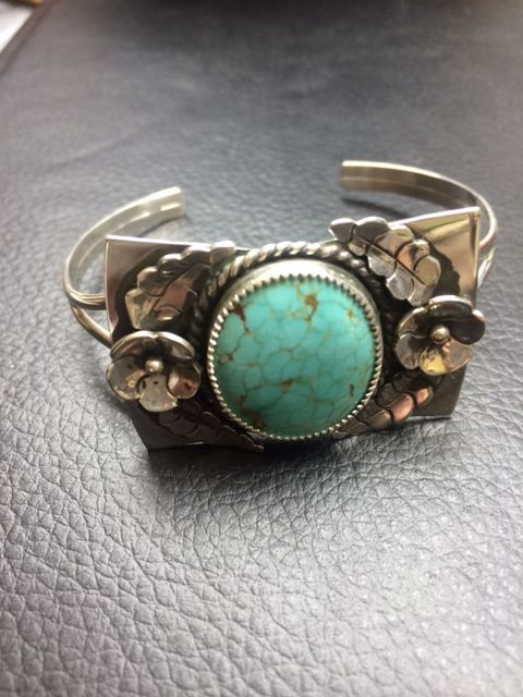 Argento Bello- Artist Amberlie Bandini. Sterling Silver set Turquoise cuff bracelet with blossom and leaf accents.