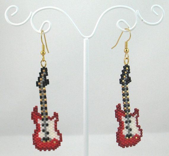 The item up for sale is a pair of beaded earrings. The design features a rockin red electric guitar.    The main portion of the earring is constructed