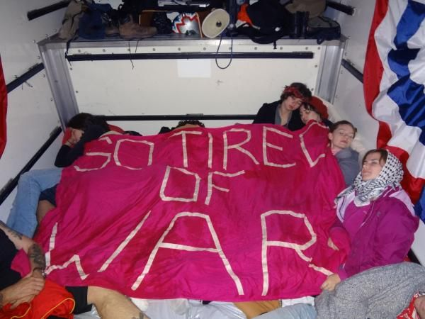 SO TIRED OF WAR: CODEPINK women sleeping in the Wikileaks truck at Occupy Wall Street, November 2011