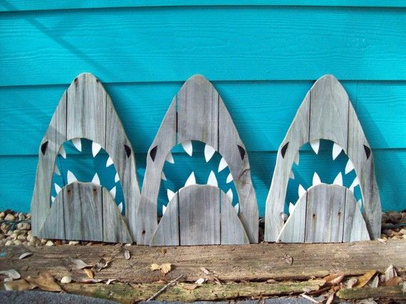 Sharks made of recycled fence wood. (Shop owner John Birdsong, Etsy) Great outdoor sculptures...