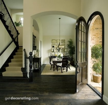 Contemporary Dining Room Just Inside The Walkway Featuring An Arch Door Dark Hardwood Floors And A U Stairwell Off Side As Most People Envision Their