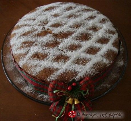 Vasilopita - Traditional Greek cake that is cut at midnight New Year's eve.