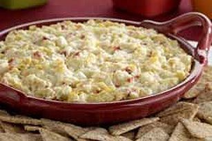 Hot Artichoke Dip  Ingredients  1can (14 oz.) artichoke hearts, drained, chopped  1pkg. (8 oz.) ATHENOS Traditional Feta Cheese, crumbled  1cup KRAFT Real Mayo Mayonnaise  1/2cup DI GIORNO Shredded Parmesan Cheese  1jar (2 oz.) diced pimientos, drained  1clove garlic, minced     Instructions  HEAT oven to 350°F.    COMBINE all ingredients.  SPOON into 9-inch pie plate.     BAKE 20 to 25 min. or until heated through and lightly browned.