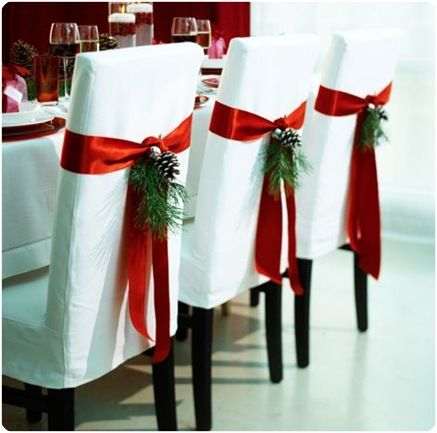 Chair Flair. The backs of your chairs are just one more place to add a decorative detail. Boxwood swags, mini wreaths, or even ornaments tied up with string add one more layer to set the scene.