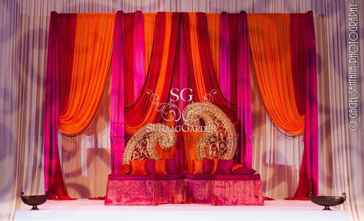 Garba stage, Suhaag Garden, Florida wedding decor and design vendor, paisely designs, cushion seating, colorful drapes