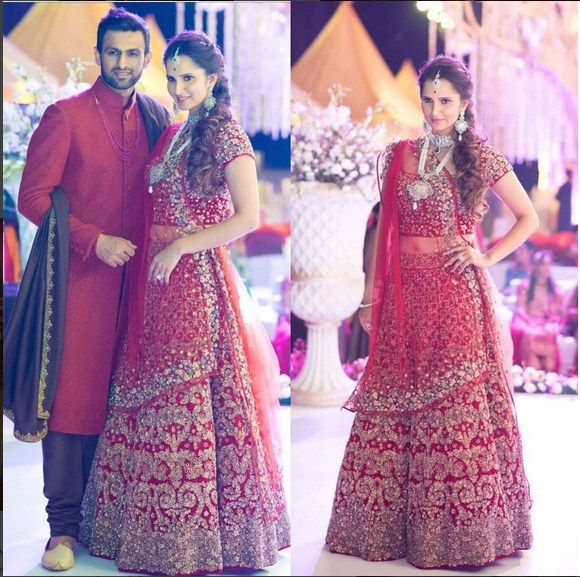 Sania Mirza In An Embroidered Lehenga Along With Her Husband In Her Sisters Wedding