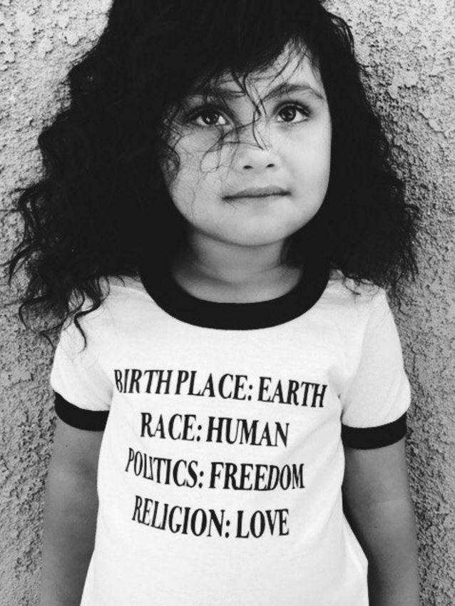 Aw such a cutie. Her shirt says it all. I hate seeing kids affected by war and violence it's so heartbreaking. If I could adopt and give them all peace of mind shelter and love I would.
