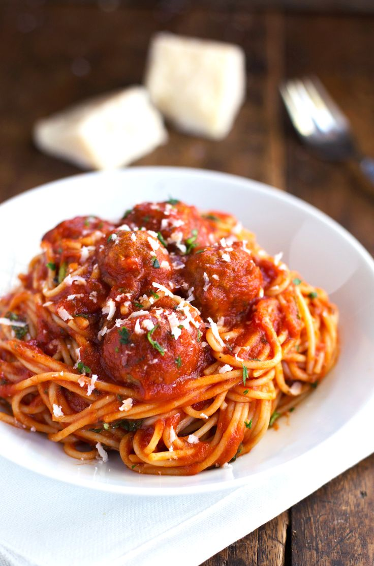This recipe for skinny Spaghetti and Meatballs uses lean ground turkey and chopped veggies to make perfect little meatballs. 325 calories.