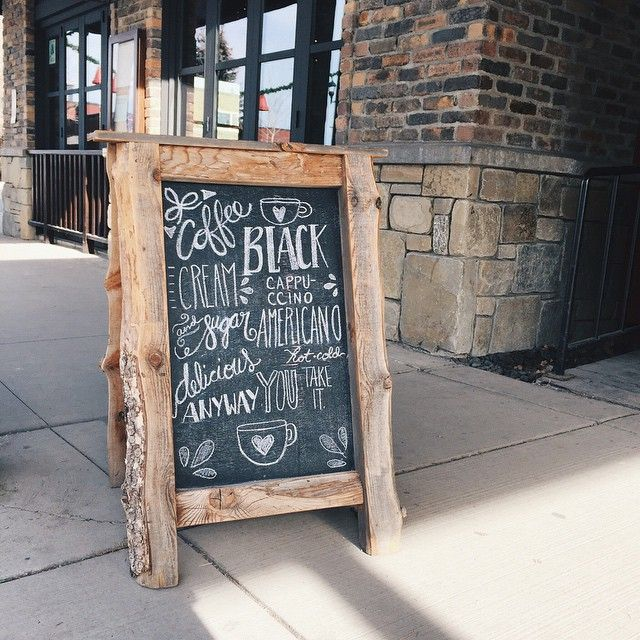 The sandwich board out front of KELLI'S coffee shop, RED CABOOSE in Whitefish, Montana