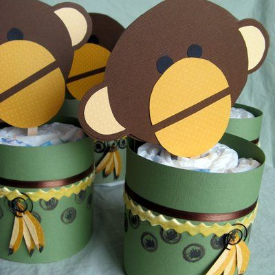 Monkey Centerpieces made of newborn diapers and cardstock.  Great for a little boy shower.