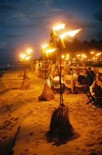 NIghttime beachside luau illuminated by tiki torches at the Four Seasons Hualalai in #Hawaii | Photo by Steve Steinhardt Photography; Event design by Beth Helmstetter Events