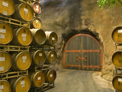 Oak Barrels Stacked Outside of Door at Ironstone Winery, Calaveras County, California, USA