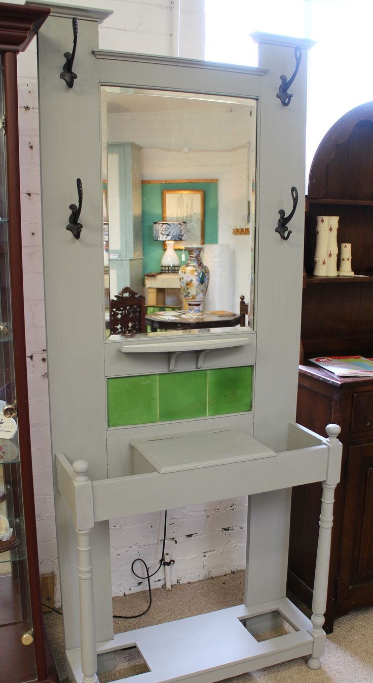 Painted Oak Arts & Crafts Hall Stand with green tiled back. 4 cast iron coat hooks & hinged key cabinet. Also available via our ebay store at http://stores.shop.ebay.co.uk/retriques.