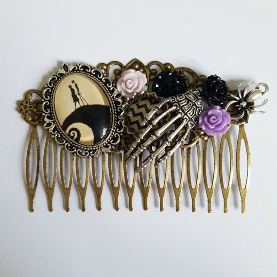 A small glass sealed handmade cameo depicting a silhouette of Disneys Jack and Sally from Tim Burtons Nightmare Before Christmas is the focal feature of this one of a kind Disney hair comb. The comb is made using an antique bronze filigree comb setting and is embellished with resin flowers, bottle cap charms and a silver plated skeleton hand and spider charm.  The small setting measures approx. 4 x 2.5cm (approx. 1.5 x 1) with the overall comb measuring 8cm (3)  All cameos are handmade in my…