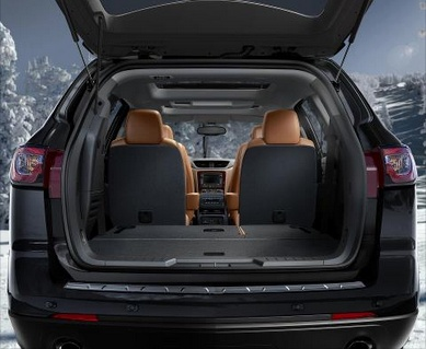 Check out all the space in the 2013 Chevy Traverse. Transporting all your cargo and up to 8 passenger in comfort and style. | Lake Chevy, Devils Lake, ND, North Dakota, Lake Motor Company, Cargo space #chevy #chevrolet #traverse #suv #holidays #cargo #trunk