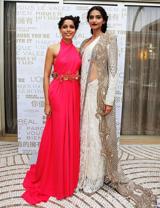 Freida Pinto and Sonam Kapoor attend a L'Oreal Cocktail Reception during The 66th Annual Cannes Film Festival at the Martinez Hotel on May 15, 2013 in Cannes, France.