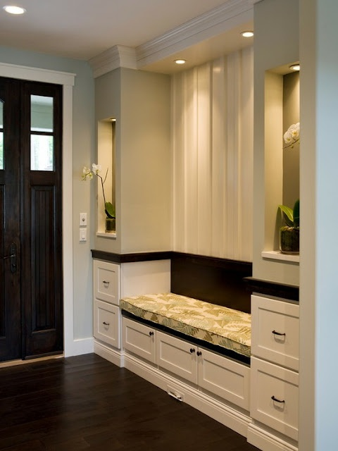 I LOVE this entry way. It is small but we could use this concept in a larger format. What great detail to this design. Everything is perfect....the design of the cabinetry, the lighting, the lit niches, the colors of the seat cushion and wall, the dark wood floors, the beautiful door color and style. Love it all!!
