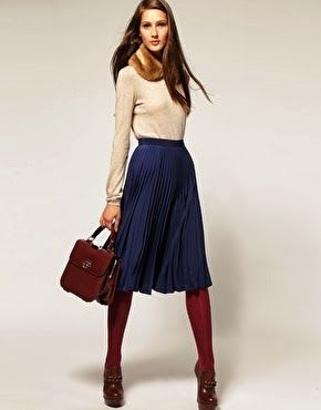 Love the navy midi skirt with burgundy tights. Great for fall or transitioning to spring