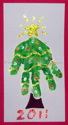 Bunch of Christmas handprint crafts. (Page not in English)