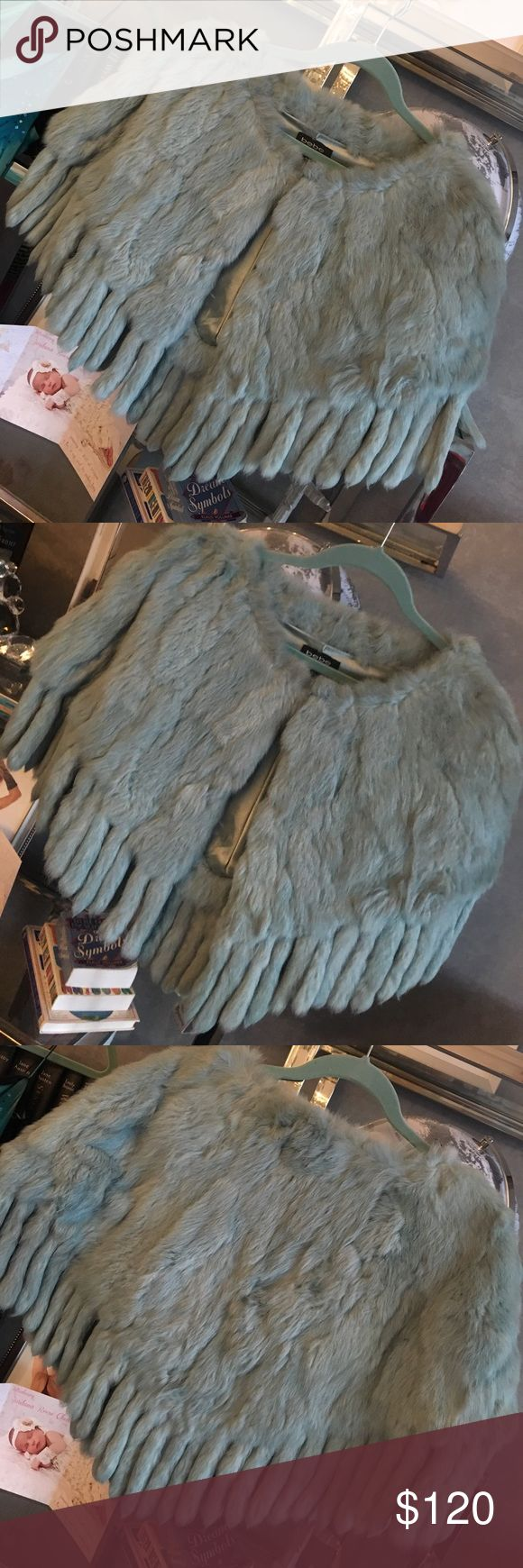 Bebe real fur Fringe jacket cape Bebe. Sz M/L. 💯 real rabbit fur. Excellent condition. Looks amazing on over a leather jacket or a cute sweater. It is a cape and has no sleeves. One cape, tag has both sizes on it so I'm listing it as both M and L. bebe Jackets & Coats Capes