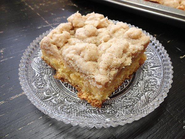 COMPANY CRUMB CAKE  For the cake  1 box of yellow cake mix (NOT pudding type)  3 eggs  1 1/3 cup water  1 tablespoon vanilla  For the crumb topping  1 pound of softened butter (4 sticks)  4 cups flour  1 1/3 cup sugar  3 tsp vanilla  3 tsp cinnamon  Pinch of salt
