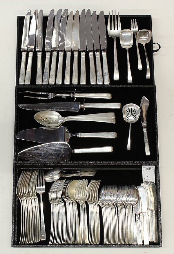 """104 pieces: American sterling silver flatware service for twelve, by Towle in the """"Craftsman"""" pattern having six pieces per place setting consisting of place knives (two with New French blades), place forks, salad forks, dessert forks, spreaders, teaspoons (24), eight soup spoons, tablespoon pierced tablespoon, serving fork, serving spoon, bon bon, cocktail fork, master knife, ladle, dessert server, pie server, carving knife and fork, most monogrammed """"M"""", 95.45 troy oz. Sold for $1,800"""