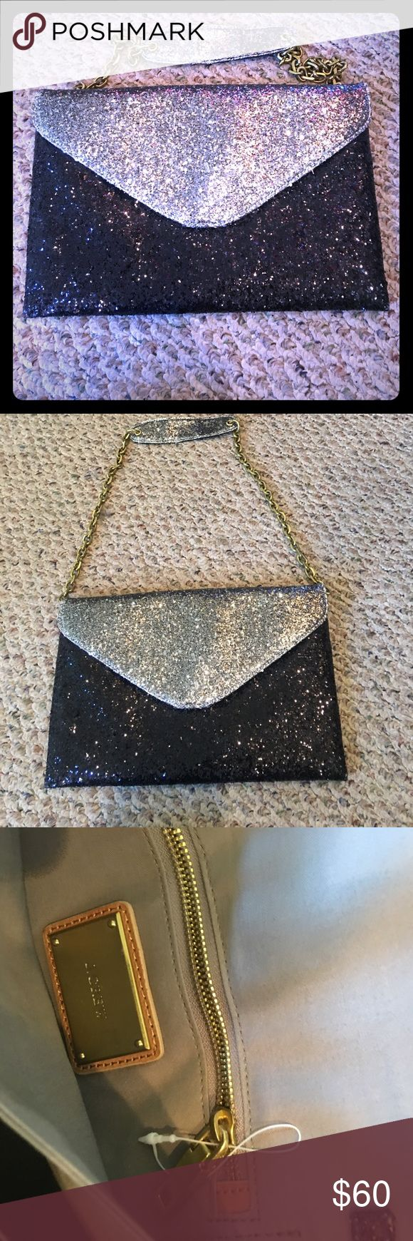 NWOT J. Crew Glitter Envelope Bag This listing is for one NWOT J. Crew black and silver glitter envelope bag. It has a bronze strap which can easily be tucked in so that it can be used as a clutch. All reasonable offers will be considered! **BUNDLE ANY PURSE WITH ANOTHER ITEM AND GET AN EXTRA 5% OFF** J. Crew Bags